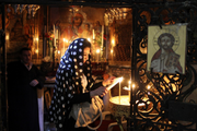Lighting Candles In the Church of the Holy Sepulchre