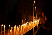 Lighting candles in the Church of holy Sepulchre